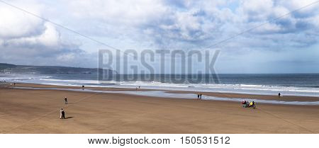 People on the beach at Whitby Yorkshire UK
