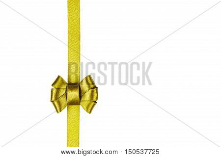 Golden satin ribbon tied in a bow isolated on white background. Christmas packaging and decoration for holiday gift or present concept.