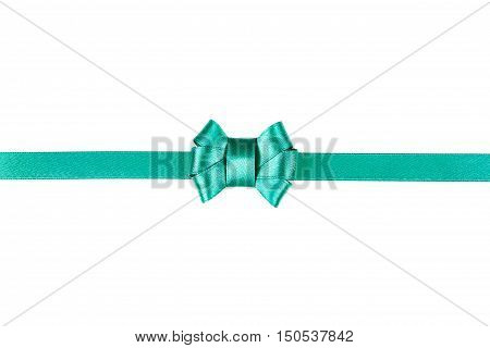 Blue satin ribbon tied in a bow isolated on white background. Christmas or new year gift or present concept.