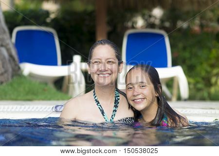 Lovely Girl And Mother Playing In Swimming Pool