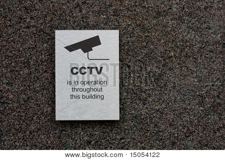 A cctv sign stating that there is cctv in the area