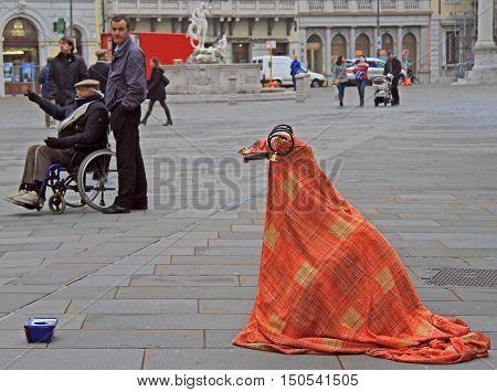 Street Artist In The Strange Costume Is Entertaining Passers