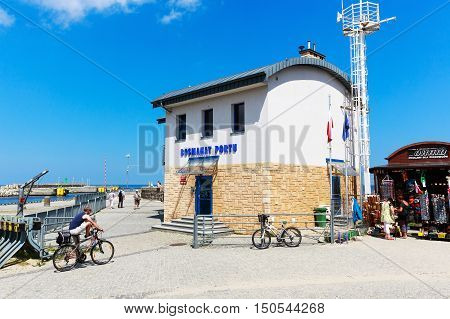 KOLOBRZEG POLAND - JUNE 22 2016: Building of the harbor boatswain located next to the wharf and the waterway between the Baltic Sea and the port
