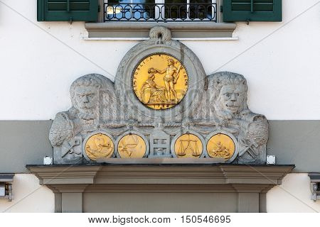 LUCERNE SWITZERLAND - MAY 04 2016: Decorative bas-relief with ornate medallion with the inscription Res Publica Lucernensis that adorns the front facade of one of the buildings on the Muehlenplatz