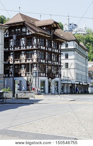 LUCERNE SWITZERLAND - MAY 08 2016: Decorative half-timbered building in the vicinity of another architecture shows the historical character of the city