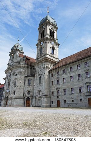 EINSIEDELN SWITZERLAND - MAY 09 2016: Front facade of Benedictine Abbey that is dedicated to Our Lady of the Hermits it is a part of the monastery complex and is located in the Canton of Schwyz