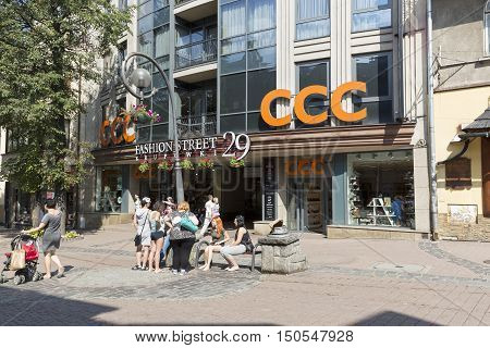 ZAKOPANE POLAND - SEPTEMBER 12 2016: Gateway to Fashion Street avenue of boutiques of the world's top brands. The main entrance can be seen from Krupowki Street