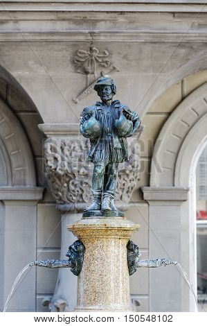 LUCERNE SWITZERLAND - MAY 08 2016: Goose Man fountain that is replica of famous Goose man of Nuremberg that were made in many copies and can be meet in many other places