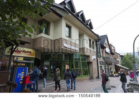 ZAKOPANE POLAND - SEPTEMBER 20 2016: McDonalds restaurant branch that was built in the years 1993-1995 is located at Krupowki street in downtown