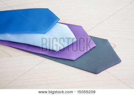 Ties on a wooden surface