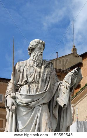 Statue of Saint Paul the Apostle with the chimney of Sistina Chapel on the background. Vatican City State