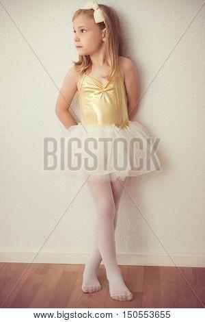 Pretty Ballet Child Girl In White Tutu Staying