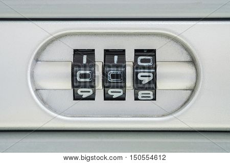 Closeup code number for lock the old suitcase background with 009 password