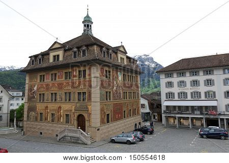 SCHWYZ SWITZERLAND - MAY 09 2016: The Town Hall walls paintings commemorates the celebration of 600 years Swiss Confederation since the 19th century. The building itself was built in 17th century