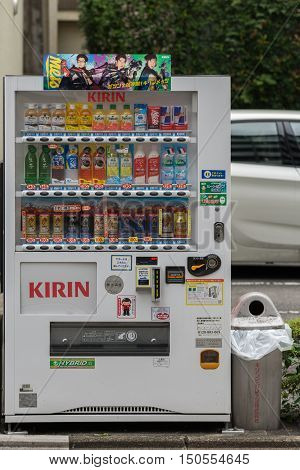 Kyoto Japan - September 14 2016: Closeup of a white Kirin vending machine in the street dispersing soft drinks such as water tea coffee lemonade