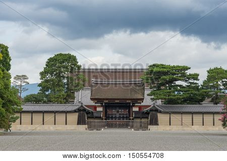 Kyoto Japan - September 14 2016: The south gate of the Imperial Palace is called the Kenrei-mon Gate. The roof of the Shishinden reception hall towers above it under heavy skies.
