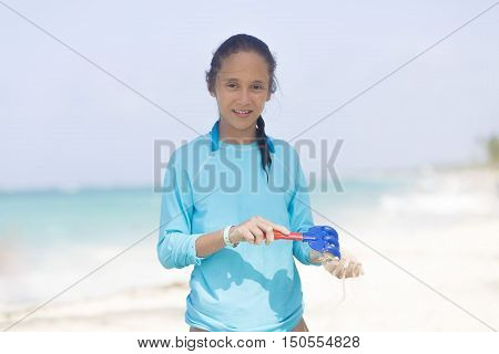 Beautiful Girl Playing At The Beach