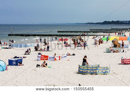KOLOBRZEG POLAND - JUNE 19 2016: Unidentified vacationers are relaxing and sunbathing on the shore of the Baltic Sea