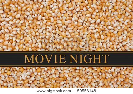 It is Movie Night message Popcorn kernels background and text Movie Night