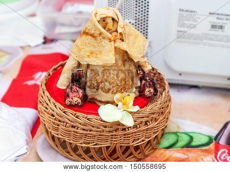 SAMARA RUSSIA - FEBRUARY 22 2015: Shrovetide effigy made of pancakes close up. Appetizing fried pancakes during Pancake Week