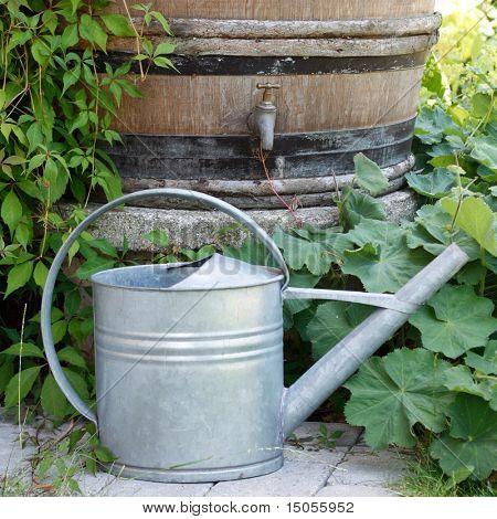A water barrel outside in a garden