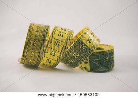 sewing centimeter yellow color on a white background