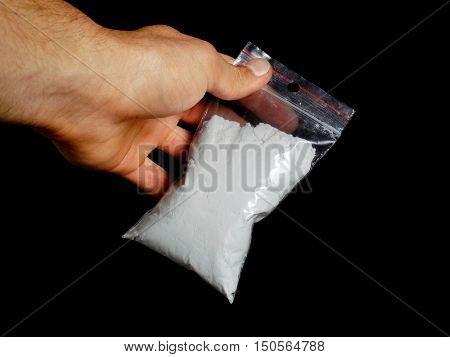 Men holding bag with cocaine drug powder, men selling drugs junkie