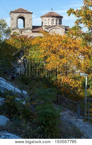 Yellow trees and Church of the Holy Mother of God in Asen's Fortress, Asenovgrad, Plovdiv Region, Bulgaria