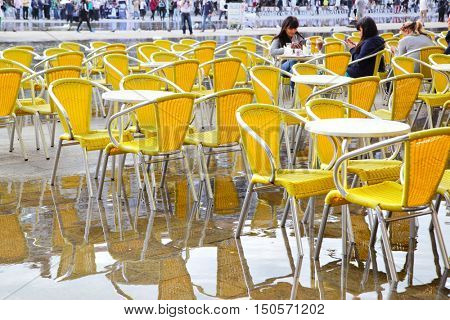 VENICE, ITALY - October 02, 2013:  People in a cafeteria on Saint Mark's square in Venice in autumn