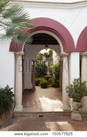 Entrance arch of a typical spanish andalusian patio in Roc de Sant Gaieta Tarragona Catalunya Spain.