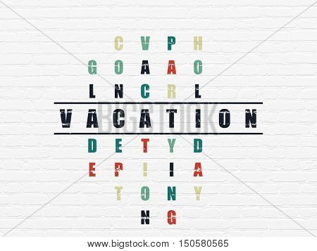 Holiday concept: Painted black word Vacation in solving Crossword Puzzle