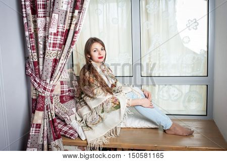 Young Woman Sitting On Sill.