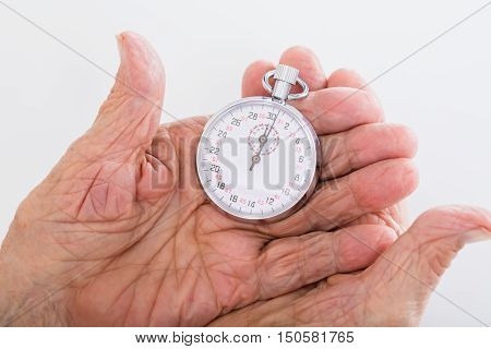 Close-up Of Businesswoman Holding Stop Watch In His Hand