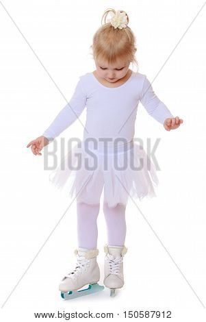 Happy little girl , future skater, white sports dress and white figure skates on two skids -Isolated on white background