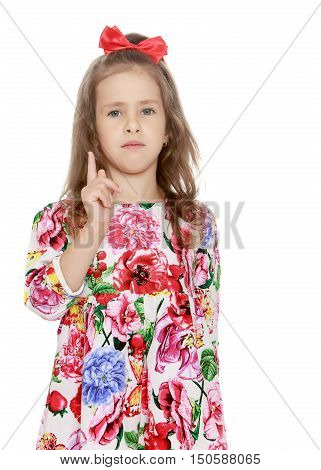 Closeup, strict little girl threatens with a finger - Isolated on white background