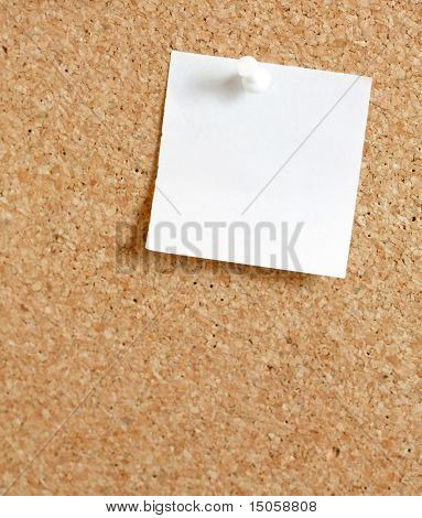 Pins on a wooden notice board