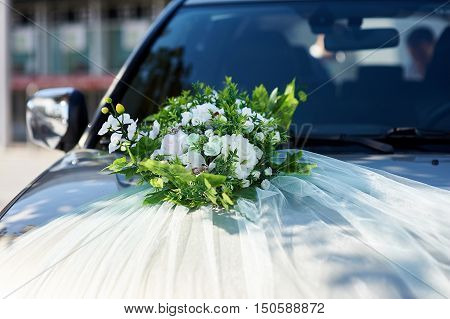 Luxury beautiful wedding car decorated with flowers.