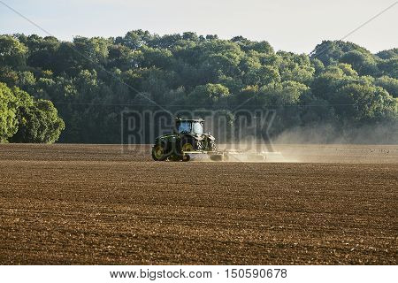October 2016. Nr Soberton Hampshire UK . A farmer Rolling his Field