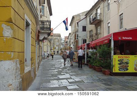 Senj Croatia - September 16 2016: old city. A small town in northern Croatia located on the Adriatic coast. The oldest parts of buildings in the old town come from the fifteenth century. Potok street, pubs, restaurants and some tourists.