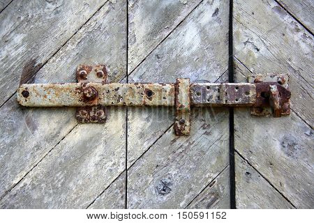Old rusty door lock on a shed in the caribbean island,