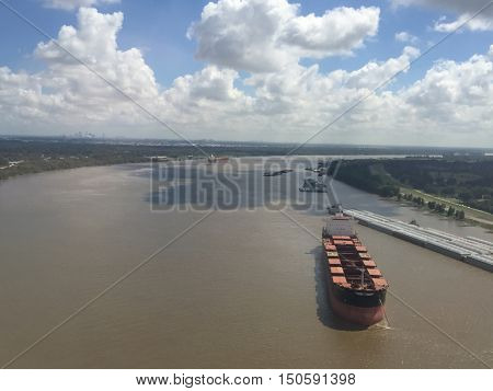 aerial view of muddy mississippi river shipping industry