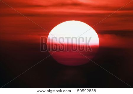 Beautiful red sunset sky with large sun.
