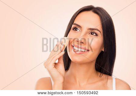 Portrait Of Pretty Woman Evening Her Skin Tone With Sponge