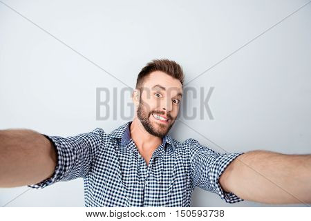 Funny Man Grimacing And Showing Teeth While Making Selfie