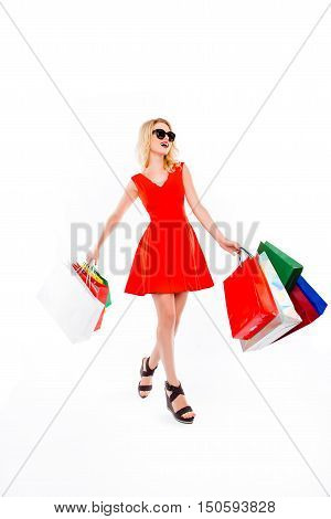 Happy Woman With Paperbags After Shopping On White Background