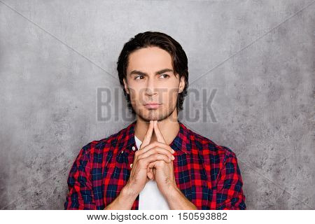 Portrait Of Young Man Thinking About Smth On Gray Background