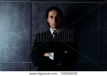 Young Brutal Handsome Man In Suit With Crossed Hands