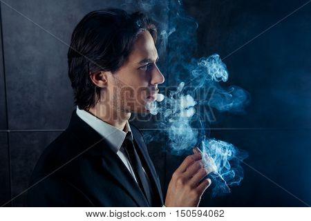 Side View Photo Of Brutal Handsome Man  Smoking A Cigar