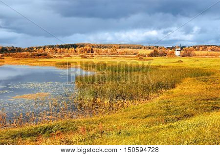 Autumn picturesque landscape -autumn view of Malenets lake and valley in Pushkinskiye Gory Russia. Autumn natural landscape of autumn nature in sunny autumn weather. Autumn colorful valley landscape