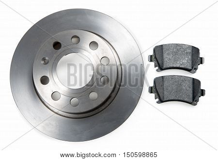 a car brake disc and pads on white background